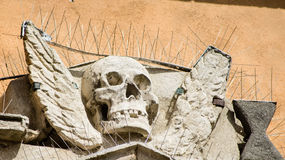 Skull sculpture of a medieval building Stock Photos