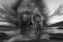 Skull on a sea, sad and bad weather background ,concept hallowee Royalty Free Stock Photos