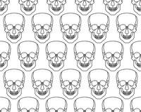 Skull seamless pattern. Seamless pattern of the cartoon skulls Stock Image