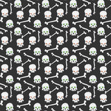 Skull seamless pattern. Seamless pattern with ominous skulls with the burning eye-sockets and bones Stock Images