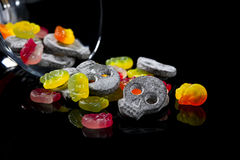 Skull shaped liquorice and wine gums. Wine gum and licorice candy in skull shapes Royalty Free Stock Images