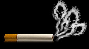 Skull shaped smoke comes out from cigarette. With reflection Royalty Free Stock Images