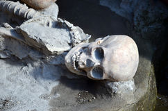 Skull and skeleton of long time ago dead men in the ruins of Ercolano Italy Stock Photo