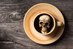 Skull soak in coffee. Still life photography : human skull soak in coffee cup in harmful effect from Caffeine concept Stock Photos