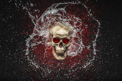 Skull Splash. Skull with clear water splashing around it with red glowing lines behind it as well Stock Photography
