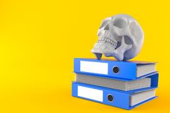 Skull with stack of ring binders. Isolated on orange background Royalty Free Stock Photo