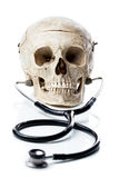 Skull with a stethoscope. Royalty Free Stock Photo