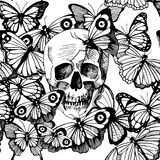 Skull surrounded and covered with multiple butterflies Royalty Free Stock Photo