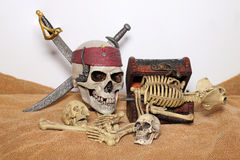 Skull and swords pirate of the Caribbean with Old wooden chest on the brown fabric. Royalty Free Stock Photos