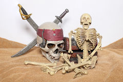 Skull and swords pirate of the Caribbean with Old wooden chest on the brown fabric. Stock Images