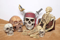 Skull and swords pirate of the Caribbean with Old wooden chest on the brown fabric. Stock Image