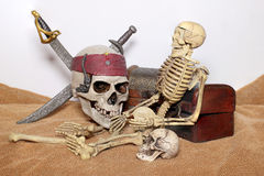 Skull and swords pirate of the Caribbean with Old wooden chest on the brown fabric. Stock Photography