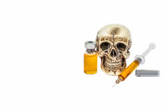 Skull and syringe. Skull and drug syringe with copy space Royalty Free Stock Images