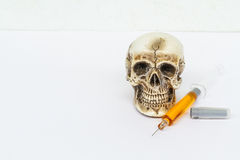 Skull and syringe Stock Photography