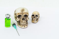 Skull and syringe Royalty Free Stock Photos