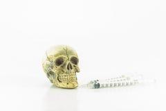 Skull syringes Stock Images