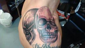 Skull tattoo. Shoulder tattoo skulls stock photo