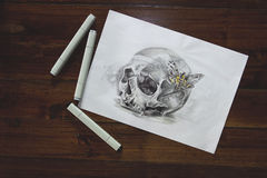 Skull tattoo sketch. Tattoo sketch of skull with felt pens on wooden background royalty free stock photography