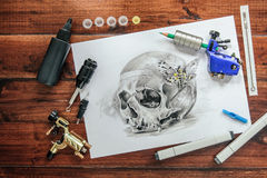 Skull tattoo sketch with rotary machines Stock Photography