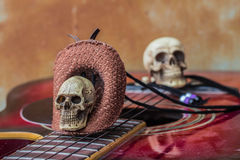 Skull top hat and guitar Royalty Free Stock Images