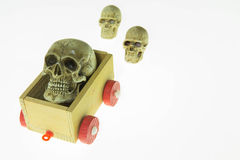 Skull on a toy carriage Stock Photography