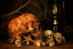 Skull under candle light, halloween theme Stock Photography