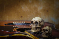 Skull on vintage. Classical guitar with skull on vintage stock images