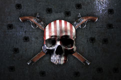 Skull and vintage pistols. Stock Photography