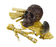 Skull with voodoo doll. Black skull with voodoo doll and magic paper isolated Stock Images
