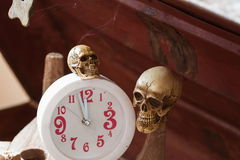 Skull waiting time on clock vintage tone Stock Image