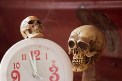 Skull waiting time on clock vintage tone Stock Photography