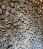 Skull wall. Wall of incised skulls in the supporting wall Royalty Free Stock Images