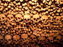 Skull Wall. A wall made of skulls and bones in a czech church stock images