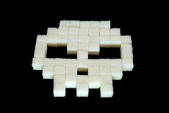 Skull from white sugar cubes. Diabetes. Royalty Free Stock Photos