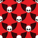 Skull with wings seamless pattern. Background of  winged head sk. Eleton. Fabric texture for Rock musicians Stock Photos