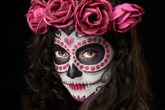Skull on woman face. Isolated on black background Stock Photography