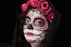 Skull woman face. With roses on black background Stock Photos