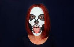 Skull woman showing tongue stock photos