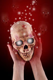 Skull. Women hand hole a Skull and liberate a Spirit ,Halloween concept Royalty Free Stock Images