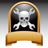Skull and wrenches in gold display Stock Photography