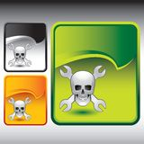 Skull and wrenches on green rip curl background Stock Image