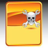 Skull and wrenches on orange background Stock Image
