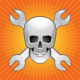Skull and wrenches on orange starburst Stock Photography