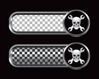 Skull and wrenches on silver and black checked ads Stock Images