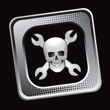Skull and wrenches in silver tilted web button Stock Image