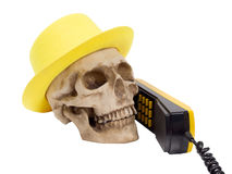 Skull in yellow hat on phone Royalty Free Stock Image