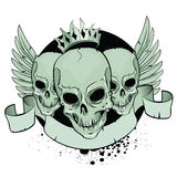 Skulls. With wings and ribbon Stock Photos