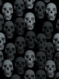 Skulls background. Black background with skulls all over it Stock Images
