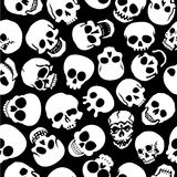 Skulls in Black Background Seamless Pattern. Great seamless pattern mad with many styles of skulls in black background Stock Photos