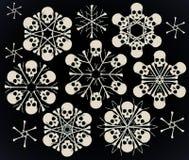Skulls and bones jolly snowlakes Stock Photos